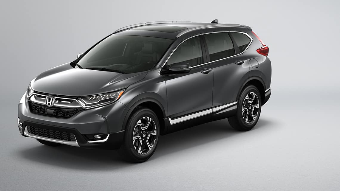 Vista frontal 3/4 de la Honda CR-V Touring2019 en Gunmetal Metallic.