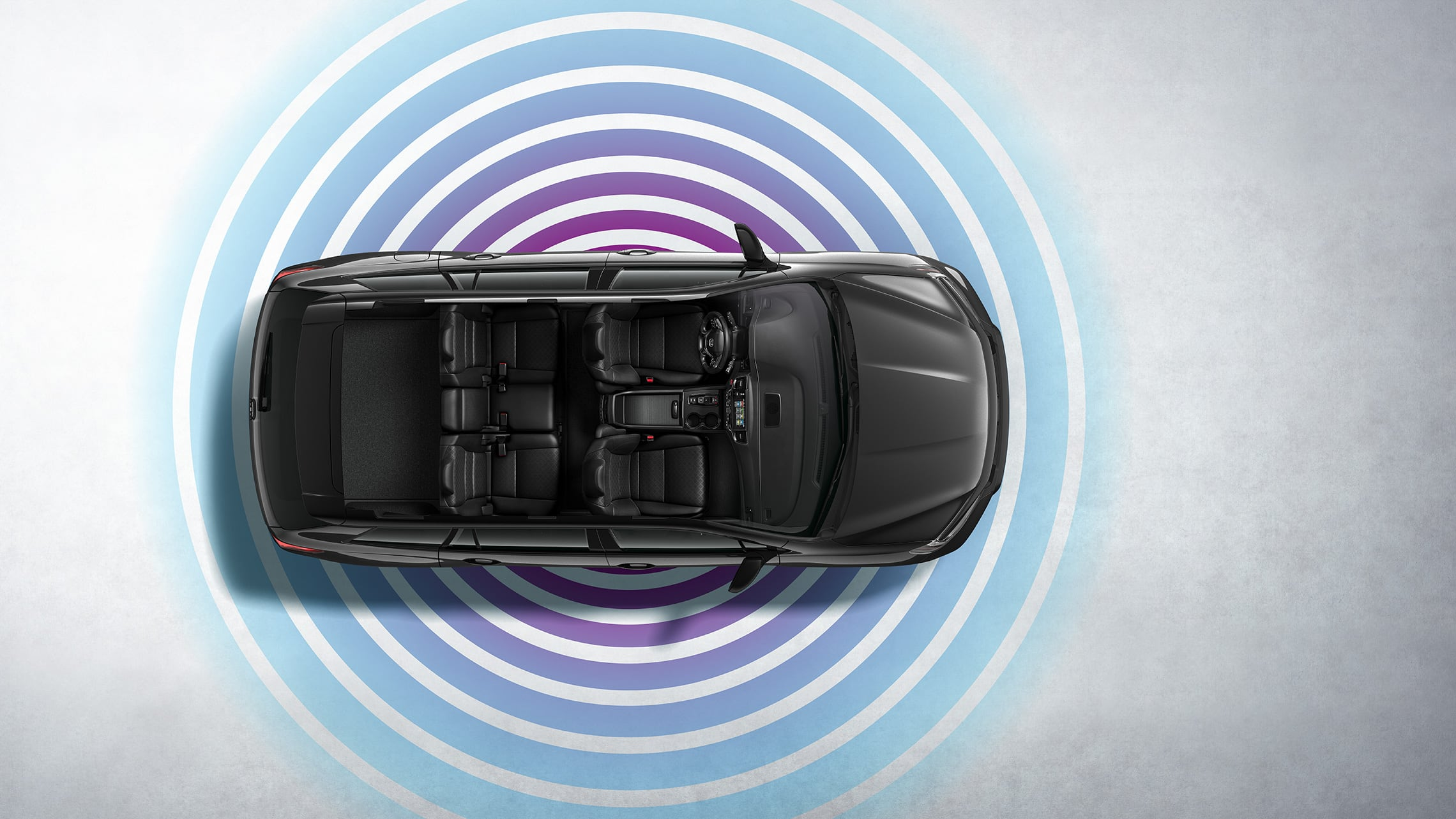Vista aérea de la Honda Passport Elite2019 en Modern Steel Metallic que muestra la característica de compatibilidad con 4G.