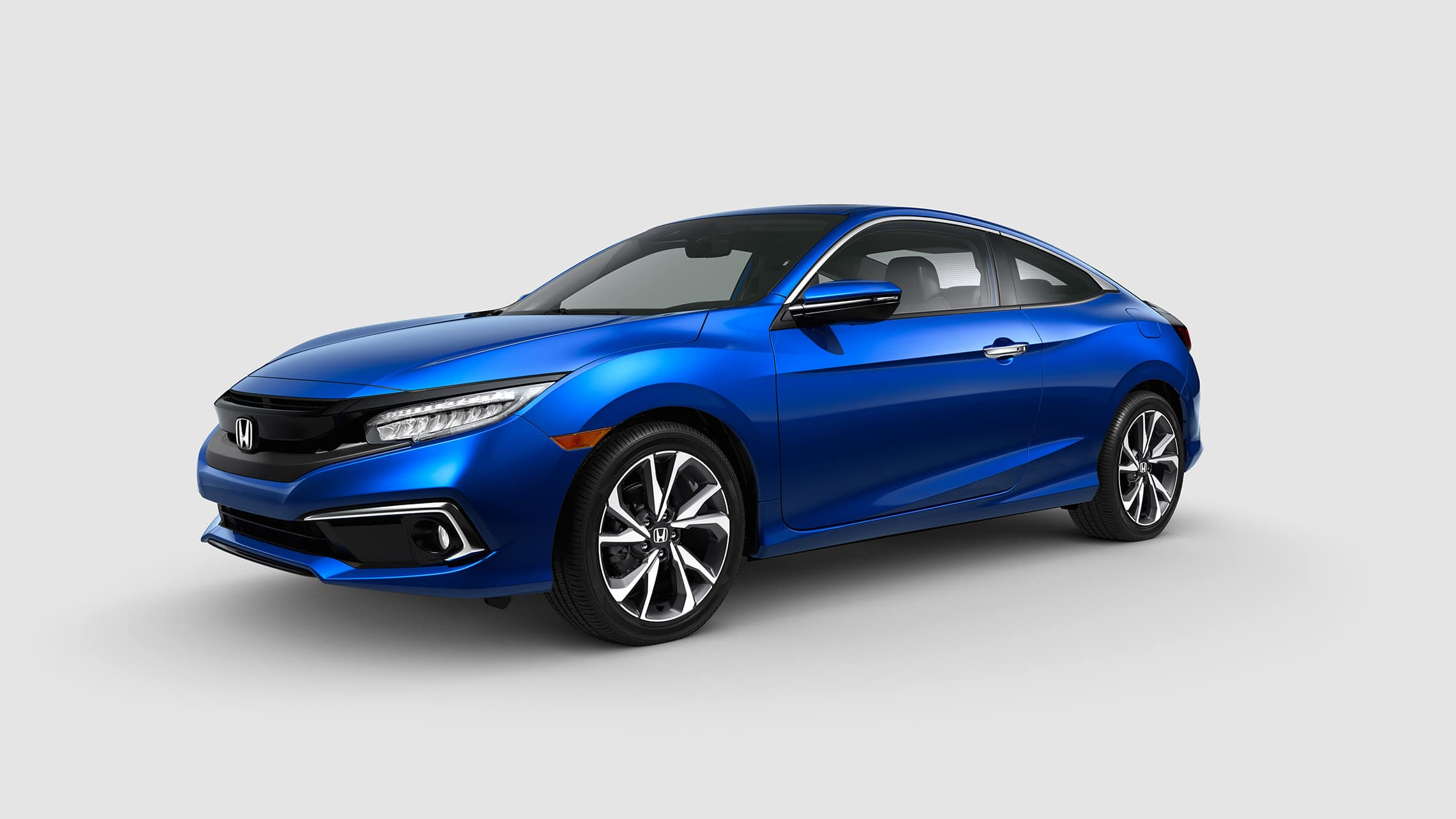 Front driver-side view of the 2020 Honda Civic Touring Coupe in Aegean Blue Metallic.