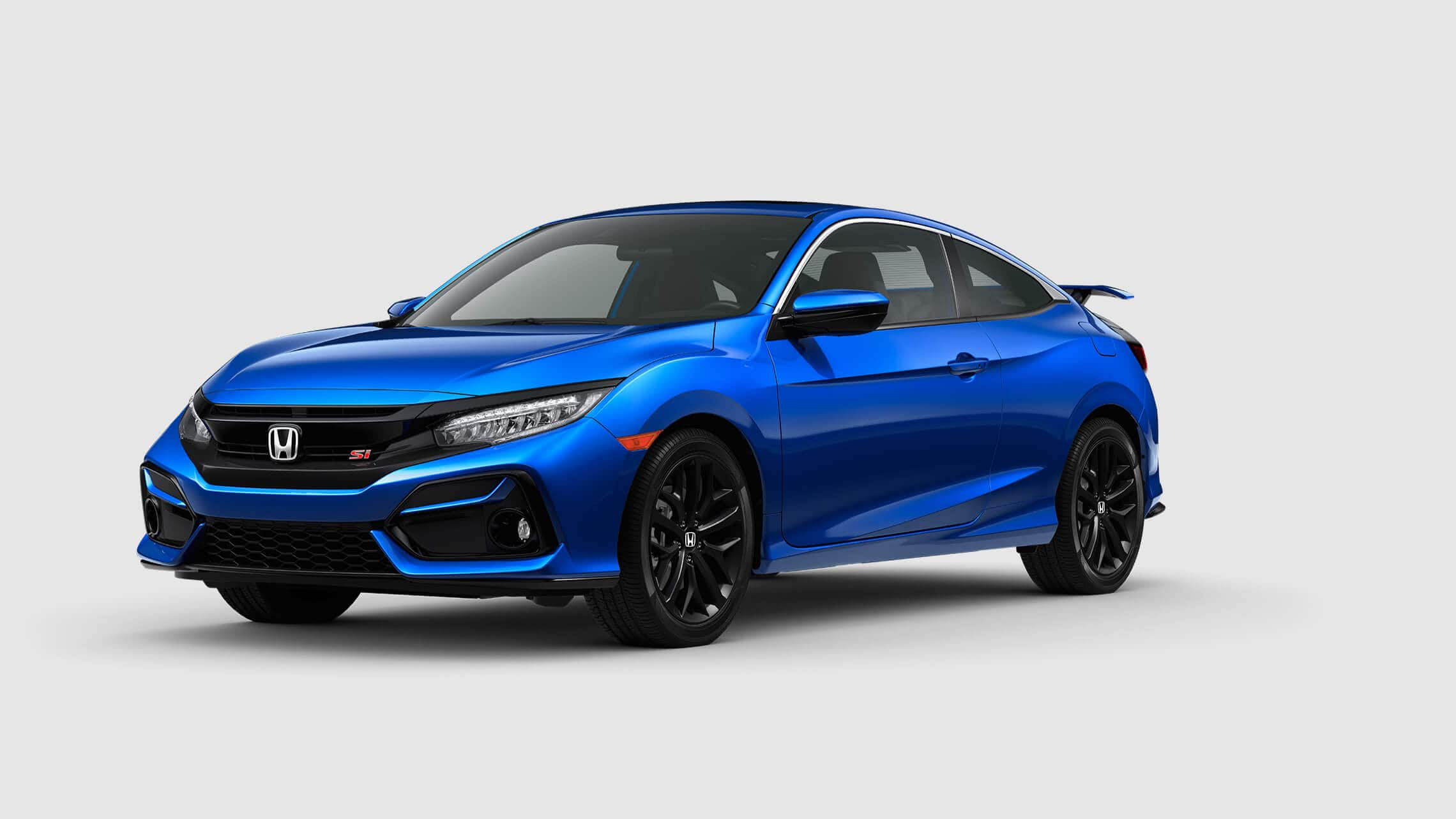 Front 3/4 driver's side view of 2020 Honda Civic Si Sedan in Aegean Blue Metallic.