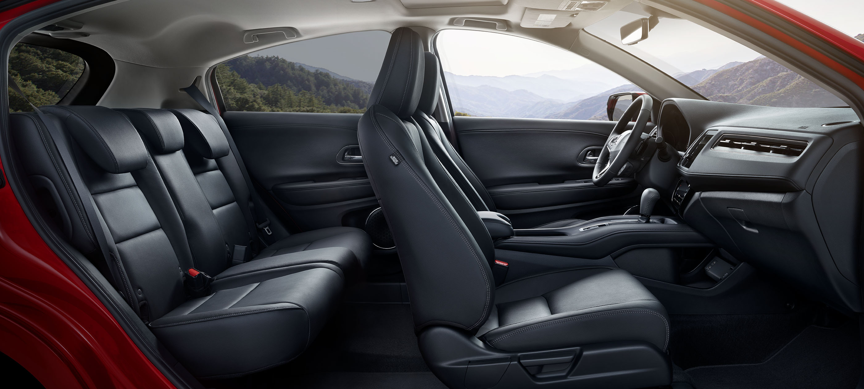 Interior cutaway illustration of the expansive legroom space inside the 2020 Honda HR-V.