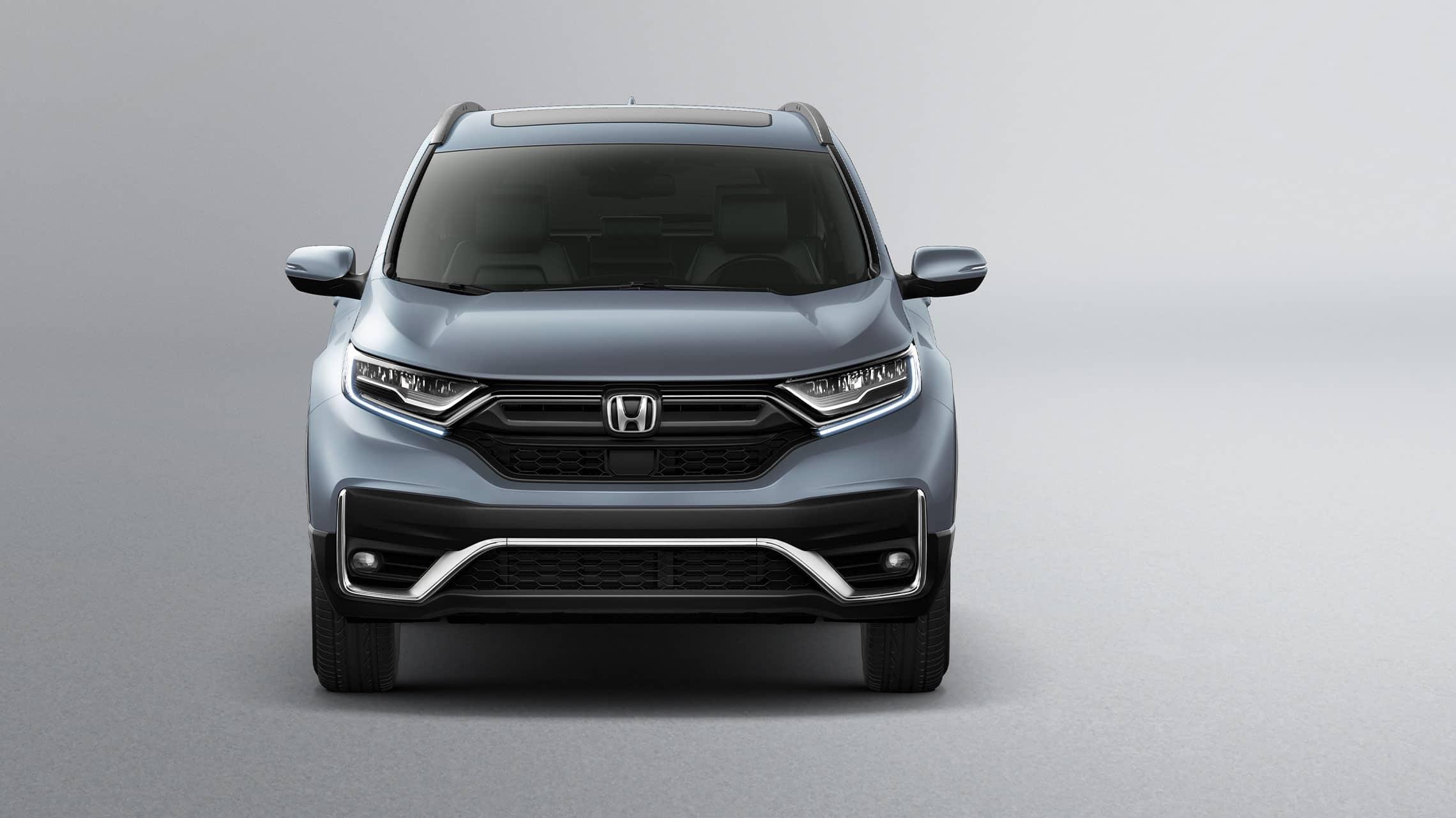 Vista frontal de la Honda CR-V Touring2021 en Sonic Gray Pearl.